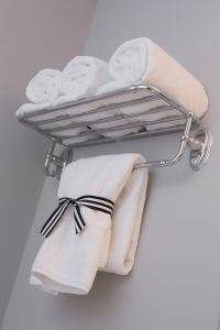 White Towels Hanging From Shelf